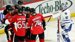 Ottawa Senators' Curtis Lazar (27) celebrates his second goal of the game with teammates Erik Karlsson (65), Mark Borowiecki (74), Ryan Dzingel (43) and Alex Chiasson (90) as Toronto Maple Leafs' goalie Jonathan Bernier (45) during third period NHL action, in Ottawa on Saturday, Feb. 6, 2016. The Ottawa Senators beat the Toronto Maple Leafs 6-1. THE CANADIAN PRESS/Fred Chartrand