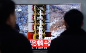 """People watch a TV news reporting a rocket launch in North Korea, at Seoul Railway Station in Seoul, Sunday, Feb. 7, 2016. For North Korea's propaganda machine, the long-range rocket launch Sunday carved a glorious trail of """"fascinating vapor"""" through the clear blue sky. For South Korea's president, and other world leaders, it was a banned test of dangerous ballistic missile technology and yet another """"intolerable provocation."""" (AP Photo/Ahn Young-joon)"""