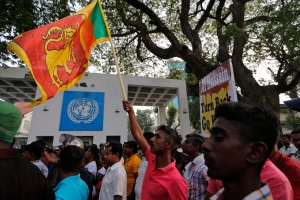 Supporters of the Sri Lankan opposition political parties backing former president Mahinda Rajapaksa protest out side the U.N. office in Colombo, Sri Lanka, Saturday, Feb. 6, 2016. Hundreds of protesters marched to the U.N office criticizing a report by UN Human Rights chief Zeid Raad al-Hussein as he began discussions with the Sri Lankan government Saturday on the measures taken by the island nation to investigate alleged atrocities committed during the long civil war. (AP Photo/Eranga Jayawardena)