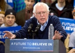 Democratic presidential candidate Sen. Bernie Sanders speaks during a campaign stop at the Franklin Pierce University Fieldhouse, Saturday, Feb. 6, 2016, in Rindge, N.H. (AP Photo/John Minchillo)