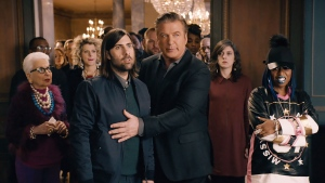 This image provided by Amazon shows a scene from the company's spot for Super Bowl 50, with Alec Baldwin, center right, and Missy Elliott, right. (Amazon via AP)