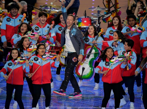 Coldplay singer Chris Martin performs during halftime of the NFL Super Bowl 50 football game Sunday, Feb. 7, 2016, in Santa Clara, Calif. (AP Photo/Charlie Riedel)