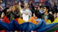 Beyonce, from left, Coldplay singer Chris Martin and Bruno Mars perform during halftime of the NFL Super Bowl 50 football game between the Denver Broncos and the Carolina Panthers, Sunday, Feb. 7, 2016, in Santa Clara, Calif. (AP Photo/Julio Cortez)