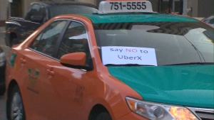 A Toronto taxi driver protests ride-sharing service Uber.