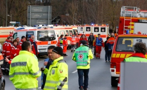 Rescue personnel wait in Bad Aibling, Germany, Tuesday, Feb. 9, 2016, after two regional trains crashed killing at least two people. (AP Photo/Matthias Schrader)