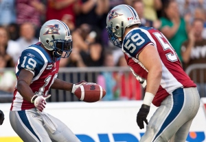 Montreal Alouettes slotback S.J. Green celebrates his touchdown againt the Toronto Argonauts with teammate tackle Josh Bourke during first quarter CFL football action on Thursday, July 29, 2010 in Montreal. (The Canadian Press/Paul Chiasson)