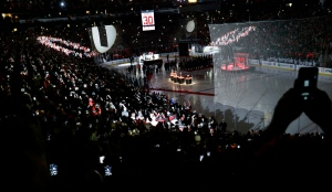 Fans take photographs as former New Jersey Devils goalie Martin Brodeur's number 30 jersey is raised in the Prudential Center arena as it is retired before an NHL hockey game against the Edmonton Oilers on Tuesday, Feb. 9, 2016, in Newark, N.J. (AP Photo/Mel Evans)