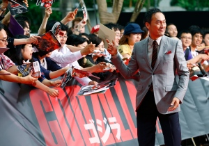 "In this July 10, 2014 file photo, Japanese actor Ken Watanabe signs autographs for fans at the Japan premiere of his movie ""Godzilla"" in Tokyo. Watanabe, one of a handful of Japanese actors who has made it on the international stage, underwent surgery for stomach cancer. But he has beaten serious sickness before, having had leukemia more than 20 years ago. The early-stage cancer was found in a medical checkup, the Tony- and Oscar-nominated actor said on his Japanese Twitter account. His publicist confirmed the sickness Tuesday, Feb. 9, 2016, noting the 56-year-old actor will be forced to delay his return to Broadway's ""The King and I."" But Watanabe said he'd be back. (AP Photo/Shizuo Kambayashi, File)"