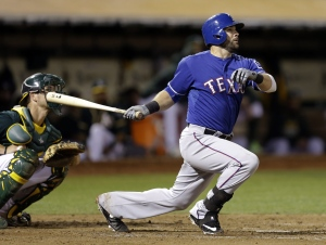 Texas Rangers' Mitch Moreland follows through on an RBI single off Oakland Athletics' Felix Doubront during the fourth inning of a baseball game Wednesday, Sept. 23, 2015, in Oakland, Calif. (AP Photo/Ben Margot)