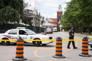 Police closed off a large area surrounding the Muzik nightclub on Canadian National Exhibition grounds in Toronto, Canada, after an early-morning shooting on Aug. 4, 2015. (The Canadian Press/Toronto Star, Bernard Weil)