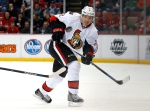 Ottawa Senators defenseman Dion Phaneuf (2) passes the puck against the Detroit Red Wings in the first period of an NHL hockey game, Wednesday, Feb. 10, 2016 in Detroit. (AP Photo/Paul Sancya)