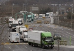 """South Korean vehicles returning from North Korea's joint Kaesong Industrial Complex pass the customs, immigration and quarantine office near the border village of Panmunjom in Paju, South Korea, Thursday, Feb. 11, 2016. North Korea on Thursday ordered a military takeover of the factory park that was the last major symbol of cooperation with South Korea, saying Seoul's suspension of operations at the jointly run facility was a """"dangerous declaration of war."""" (AP Photo/Ahn Young-joon)"""