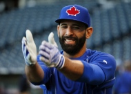 Toronto Blue Jays right-fielder Jose Bautista warms up before Game 1 of baseball's American League Championship Series against the Kansas City Royals on Friday, Oct. 16, 2015, in Kansas City, Mo. THE CANADIAN PRESS/AP-Paul Sancya