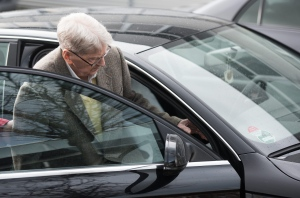 94-year-old former SS guard at the Auschwitz death camp Reinhold Hanning leaves in car after the opening of his trial in Detmold, Germany, Thursday, Feb. 11, 2016. Hanning faces trial for 170,000 counts of accessory to murder, the first of up to four cases being brought to court this year in an 11th-hour push by German prosecutors to punish Nazi war crimes. (Bernd Thissen/Pool Photo via AP)
