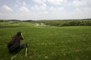 A photographer takes a photo of the site of the 1969 Woodstock Festival during a press tour of Bethel Woods in Bethel, N.Y., Tuesday, May 30, 2006. (AP Photo/ Jim McKnight)