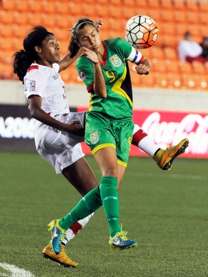 Canada's Ashley Lawrence, left, and Guyana's Ashley Rodrigues go after the ball during the second half of a CONCACAF Olympic qualifying tournament soccer match Thursday, Feb. 11, 2016, in Houston. Canada won 5-0. (AP Photo/Pat Sullivan)