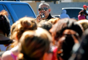 A Glendale police offer speaks to parents, Friday, Feb. 12, 2016, in Glendale, Ariz., after two students were shot and killed at Independence High School in the Phoenix suburb. (AP Photo/Matt York)