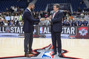 Toronto's Mayor John Tory, right, hands Drake the key to the city ahead of the celebrity all-star game in Toronto on Friday, Feb. 12, 2016. (The Canadian Press/Chris Young)