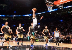 Team United States Zach LaVine slam dunks the ball past Team World players during second half NBA rising stars all-star basketball action in Toronto on Friday, Feb. 12, 2016. (The Canadian Press/Mark Blinch)