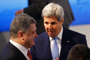 U.S. Secretary of State, John Kerry, right, talks to Ukrainian President Petro Poroshenko at the Security Conference in Munich, Germany, Saturday, Feb. 13, 2016. (AP Photo/Matthias Schrader)
