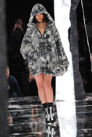 Rihanna greets the audience after FENTY PUMA by Rihanna is shown during New York Fashion Week, Friday, Feb. 12, 2016. (AP Photo/Diane Bondareff)