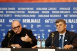 Director Gianfranco Rosi, left, and protagonist Pietro Bartolo attend a press conference for the competition film 'Fire At Sea' at the 2016 Berlinale Film Festival in Berlin, Saturday, Feb. 13, 2016. (AP Photo/Axel Schmidt)