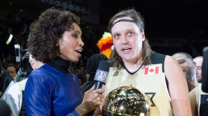 Team Canada's Win Butler of Arcade Fire (right) holds the MVP trophy as he is interviewed by ESPN's Sage Steele following the NBA celebrity All-Star game in Toronto on Friday, February 12, 2016. THE CANADIAN PRESS/Chris Young