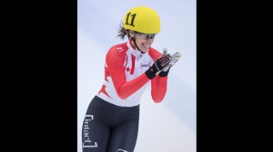 Canada's Marianne St-Gelais reacts after crossing the finish line  as she won  the women's 500 m final at the ISU Short track World Cup event in Dresden, Germany, Sunday Feb. 7, 2016. (Sebastian Kahmert/dpa via AP)