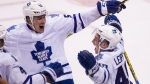 Toronto Maple Leafs' Brendan Leipsic (49) celebrates his first career NHL goal with teammate Jake Gardiner (51) during third period NHL hockey action against the Vancouver Canucks in Vancouver, B.C., on Saturday February 13, 2016. THE CANADIAN PRESS/Ben Nelms