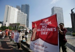 Muslim activists display posters during a protest against Valentine's Day in Jakarta, Indonesia, Sunday, Feb. 14, 2016. Dozens of activists staged the protest calling on Muslims to avoid the celebration of the western holiday, saying that it's against Islamic teachings and could lead to forbidden sexual relations. (AP Photo/Achmad Ibrahim)
