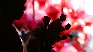 A Filipino vendor arranges roses at a flower market in Manila, Philippines on Valentine's Day, Sunday, Feb. 14, 2016. (AP Photo/Aaron Favila)