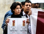 FILE - In this Jan. 24, 2015 photo, 32-year-old mother Shaimaa el-Sabbagh holds a poster during a protest in downtown Cairo. Egypt's highest appeals court on Sunday, Feb. 14, 2016 overturned the conviction of a police officer sentenced to 15 years in prison for the killing of a el-Sabbagh in a January 2015 shooting captured on video and photos. (AP Photo/Mohammed El-Raaei, File