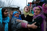 Relatives of Shaista Hamid mourn during her funeral in Lilhar south of Srinagar, Indian controlled Kashmir Sunday, Feb. 14, 2016. A teenage boy and a young woman were killed during an anti-India protest that followed the killing of a local rebel in a gunbattle with government forces in the disputed Himalayan region of Kashmir on Sunday, officials and eyewitnesses said. Anti-India sentiment runs deep in Kashmir, where rebel groups have fought since 1989 for either independence or a merger with neighboring Pakistan. India and Pakistan each administer a portion of Kashmir, but both claim the region in its entirety. (AP Photo/Mukhtar Khan)