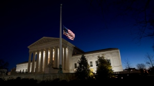 An American flag flies at half-staff in front of the U.S. Supreme Court building in honor of Supreme Court Justice Antonin Scalia as the sun rises in Washington, Sunday, Feb. 14, 2016. Scalia, the influential conservative and most provocative member of the Supreme Court, has died. He was 79. (AP Photo/Manuel Balce Ceneta)
