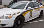 A Surete du Quebec police car is shown in Levis, Que., Friday, October 12, 2012. Quebec provincial police have identified the police officer who was fatally shot in the line of duty in Lac-Simon on Saturday night as 26-year-old Thierry Leroux. THE CANADIAN PRESS/Jacques Boissinot