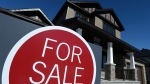 A sign advertises a new home for sale in Carleton Place, Ont., on March 17, 2015. (Sean Kilpatrick / THE CANADIAN PRESS)