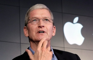 FILE - In this April 30, 2015, file photo, Apple CEO Tim Cook responds to a question during a news conference at IBM Watson headquarters, in New York. Cook said his company will resist a federal magistrate's order to hack its own users in connection with the investigation of the San Bernardino, Calif., shootings. In a statement posted early Wednesday, Feb. 17, 2016, on the company's website, Cook argued that such a move would undermine encryption by creating a backdoor that could potentially be used on other future devices. (AP Photo/Richard Drew, File)