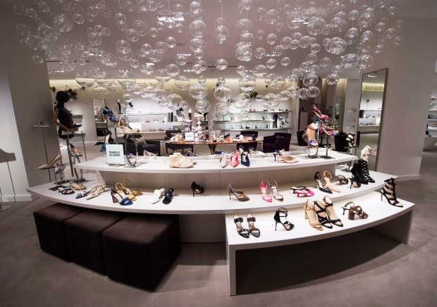 62646b2f52a Women s shoes are shown inside Saks Fifth Avenue the company s new store in  downtown Toronto on Tuesday