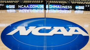 In this March 18, 2015, file photo, the NCAA logo is shown at center court at The Consol Energy Center in Pittsburgh. (AP Photo/Keith Srakocic)