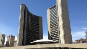 People walk in front of Toronto City Hall. (Chris Kitching/CP24)