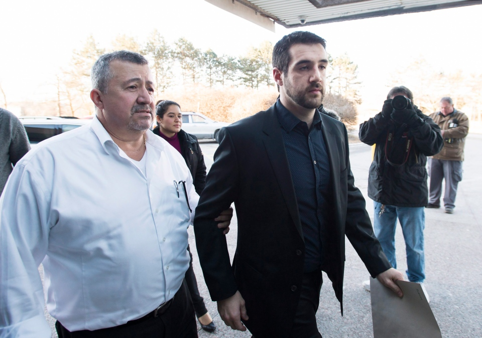 Marco Muzzo, right, arrives with family at the court house for his sentencing hearing in Newmarket, Ont., on Tuesday, February 23, 2016. Muzzo, 29, pleaded guilty earlier this month to four counts of impaired driving causing death and two of impaired driving causing bodily harm. THE CANADIAN PRESS/Nathan Denette
