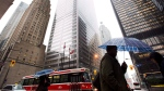 People walk in Toronto's financial district in Toronto, on Oct. 29, 2012. THE CANADIAN PRESS/Nathan Denette