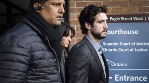 Marco Muzzo, right, leaves the Newmarket courthouse surrounded by family, on February 4, 2016. THE CANADIAN PRESS/Christopher Katsarov