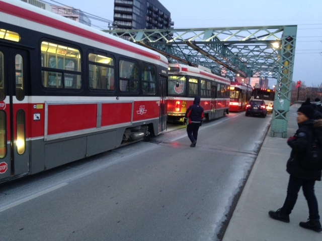 A line of streetcars are seen near Queen and River streets. (Cam Woolley/ CP24)