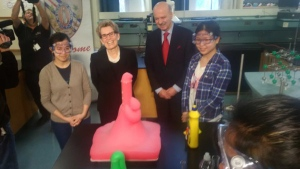 Premier Kathleen Wynne poses with some students during a science demonstration at Jarvis Collegiate Institute Tuesday March 1, 2016. (@robertbenzie /Twitter)