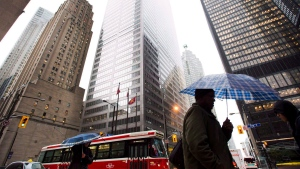 People walk in Toronto's financial district in Toronto, on Oct. 29, 2012. (The Canadian Press/Nathan Denette)