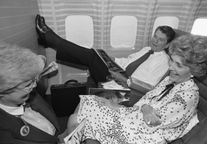 In this July 19, 1980 file photo taken by Walt Zeboski, Republican presidential nominee Ronald Reagan props his feet up as wife Nancy, foreground, talks with unidentified woman aboard an airplane, in Los Angeles.  (AP Photo/Walt Zeboski, File)