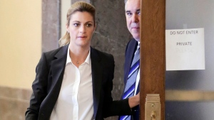 Sportscaster and television host Erin Andrews and attorney Scott Carr walk to the courtroom Monday, March 7, 2016, in Nashville, Tenn. (AP Photo/Mark Humphrey)