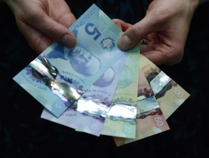 Polymer bank notes are shown during a news conference at the Bank of Canada in Ottawa on April 30, 2013. THE CANADIAN PRESS/Sean Kilpatrick