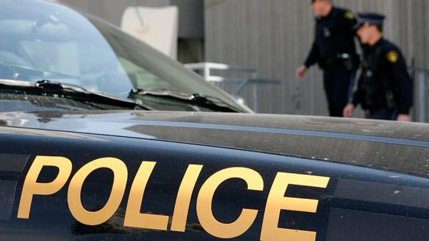 Man critical after car slams into transport truck on Highway 401